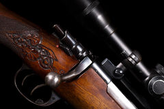 Sniper rifle telescope glass lens with bullet load Stock Photos