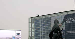 Sniper on the roof of European Parliament stock footage