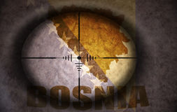 Sniper scope aimed at the bosnian flag and map Royalty Free Stock Image