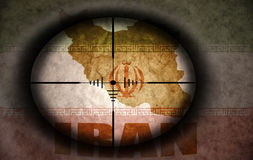 Sniper scope aimed at the iranian flag and map. Sniper scope aimed at the vintage iranian flag and map Stock Image
