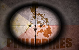 Sniper scope aimed at the philippines flag and map Royalty Free Stock Photography