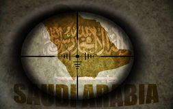 Sniper scope aimed at the saudi arabia flag and map Royalty Free Stock Photography