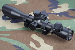 sniper scope on camouflaged uniform Royalty Free Stock Image