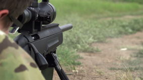 Sniper Shoots from a Rifle stock footage
