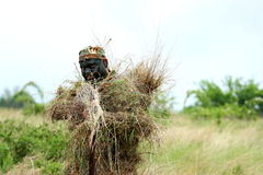 Sniper soldier. A sniper soldier with mask and weapon pointing hes weapon ready for action Royalty Free Stock Photo