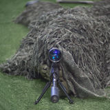 Sniper soldier. In ghillie suit aiming with precision rifle Stock Photography