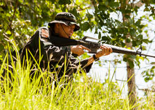 Sniper soldier trainee ready to assault Stock Photography