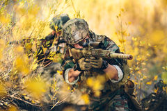 Sniper. And spotter in the field Royalty Free Stock Photography