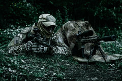 Sniper and spotter of Green Berets. US Army Special Forces Group in action Royalty Free Stock Image