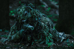 Sniper wearing ghillie suit Stock Photos