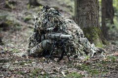 Sniper wearing ghillie suit. United states army ranger sniper wearing ghillie suit Royalty Free Stock Photography