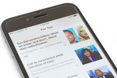Snippets of news on iPhone running iOS 9 Royalty Free Stock Image