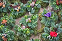 Snitch and wreaths from flowers, All Saints Day concept. Royalty Free Stock Photos