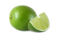 Snitt och hela limefruktfrukter som isoleras på vit bakgrund Royaltyfria Bilder