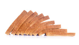 Snittet släntrar av bröd på vit Royaltyfri Foto