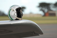 Helmet on Wing - Come fly with me. Flight helmet sits ready for pilot on the wing of a Harvard (Texan) aircraft. This aircraft was built for the US Navy in 1943 Stock Photography