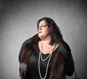 Snobbish lady. Fat elegant woman with snobbish expression stock photography