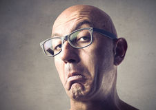 Snobbish man. Portrait of a bald man with snobbish expression royalty free stock images