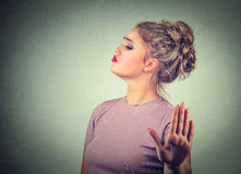 Snobby annoyed angry woman giving talk to hand gesture Royalty Free Stock Photos