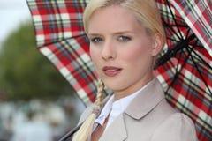 Snobby woman. Holding an umbrella Stock Photos