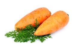 Snoepje en freash wortelen Royalty-vrije Stock Foto's