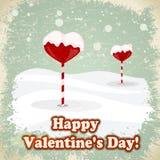 Snoepjes in de vorm van harten in de sneeuw Stock Foto's