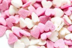 Snoepjes en suikersuikergoed op abstract patroon als achtergrond Royalty-vrije Stock Afbeeldingen