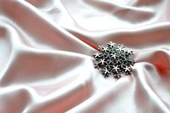 Snowflake brooch Royalty Free Stock Image
