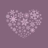 Snoflakes dans une forme de coeur sur le fond pourpre Photos stock