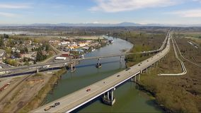 Snohomish River Route 2 Vehicle Traffic Everett Washington. Shot elevating over Everett and cars moving east on route 2 stock video