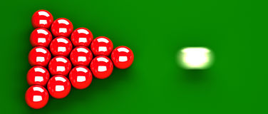 Snooker. Closeup of snooker table with red balls just before they are hit by the white ball. white ball is in motion blur. balls are on green billiard table. The Stock Image