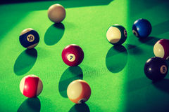 Snooker ball on billiard table. Billiard cue balls on green table. Pool game Royalty Free Stock Photography