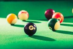 Snooker ball on billiard table. Billiard cue balls on green table. Pool game Stock Photo