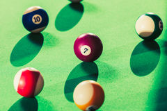 Snooker ball on billiard table. Billiard cue balls on green table. Pool game Stock Images