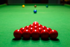 Snooker ball on a billiard table. Snooker red balls billiard table centre Royalty Free Stock Photo