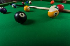 Snooker ball and stick on billiard table Royalty Free Stock Photos
