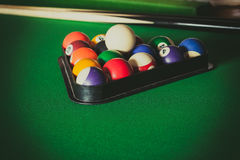 Snooker ball and stick on billiard table Royalty Free Stock Photo
