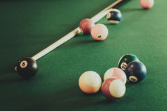 Snooker ball and stick on billiard table. Billiard balls and cue stick on green table. Pool game Stock Images