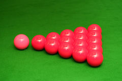 Snooker balls. Red snooker balls with the pink on the table Stock Images