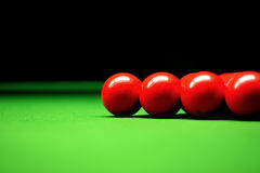Snooker balls. On green surface, shallow depth of field royalty free stock photos
