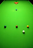 Snooker balls. On green surface, shallow depth of field royalty free stock photography