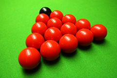 Snooker balls. On green surface, shallow depth of field royalty free stock photo