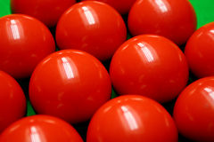 Snooker balls. On green surface, shallow depth of field royalty free stock image