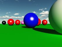 Snooker Balls. Oversized Snooker Balls on an Infinite Green Beize Royalty Free Stock Photo