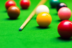 Snooker balls and cue on the table Royalty Free Stock Images