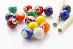 Snooker balls with cues Stock Photo