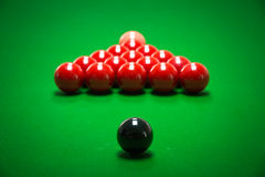 Snooker balls set. On a green table stock images