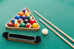 Snooker billards pool balls, cue, brush, chalk on green table. Snooker billards pool balls in triangle, chalk, cue, extender stick and brush on green table Stock Images