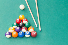 Snooker billards pool balls and cue stick on green table Stock Images
