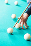 Snooker billiard game. Billiard snooker game moment. Player hand with cue hitting the ball Royalty Free Stock Image